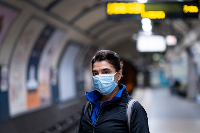 Woman wearing a mask on the London subway or tube