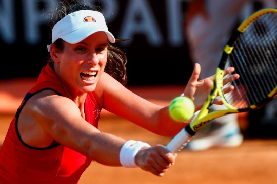 Britain's Johanna Konta plays a backhand to Spain's Garbine Muguruza during their round 3 match on day five of the Women's Italian Open at Foro Italico on September 18, 2020 in Rome, Italy.