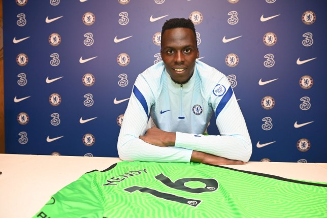 Edouard Mendy poses with his Chelsea shirt after his transfer from Rennes