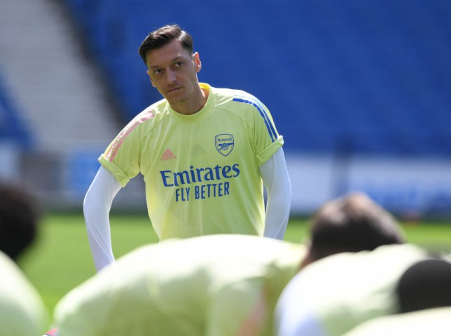 Arsenal substitute Mesut Ozil before the Premier League match between Brighton & Hove Albion and Arsenal FC at American Express Community Stadium on June 20, 2020 in Brighton, England. Football Stadiums around Europe remain empty due to the Coronavirus Pandemic as Government social distancing laws prohibit fans inside venues resulting in all fixtures being played behind closed doors.
