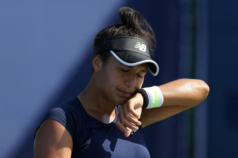 Tennis player Heather Watson wiping her face at  the St. James's Place Battle Of The Brits Team Tennis