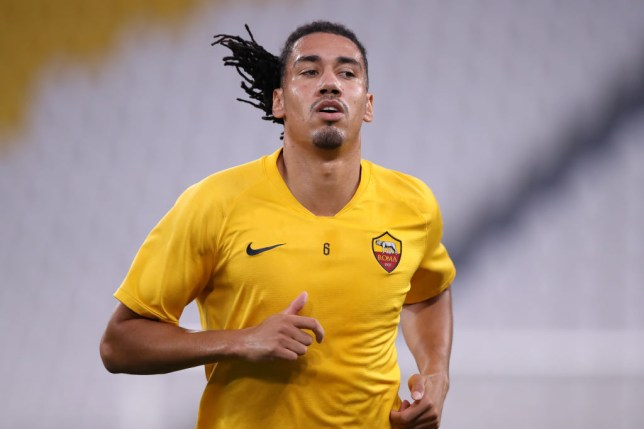 Manchester United defender Chris Smalling looks on ahead of Roma's clash with Juventus