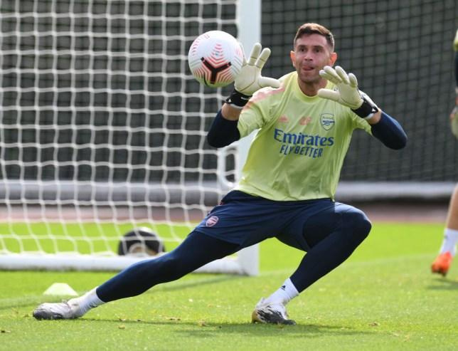 Emiliano Martinez catches the ball in Arsenal training