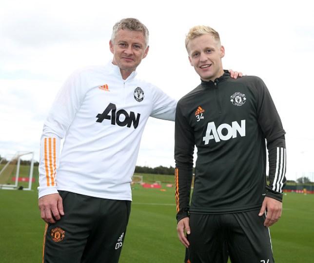 Manchester United New Signing Donny van de Beek with manager Ole Gunnar Solskjaer