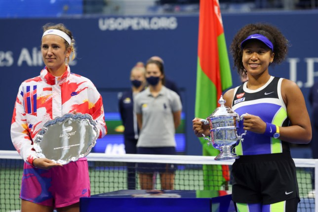 Naomi Osaka (R) of Japan holds the championship trophy and Victoria Azarenka (L) of Belarus holds the finalist trophy after their Women's Singles final match on Day Thirteen of the 2020 US Open at the USTA Billie Jean King National Tennis Center on September 12, 2020 in the Queens borough of New York City.
