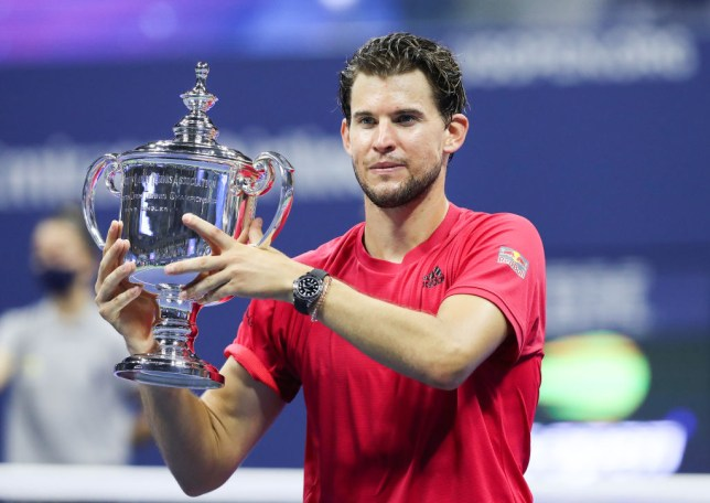 Dominic Thiem of Austria celebrates with championship trophy after winning in a tie-breaker during his Men's Singles final match against Alexander Zverev of Germany on Day Fourteen of the 2020 US Open at the USTA Billie Jean King National Tennis Center on September 13, 2020 in the Queens borough of New York City.