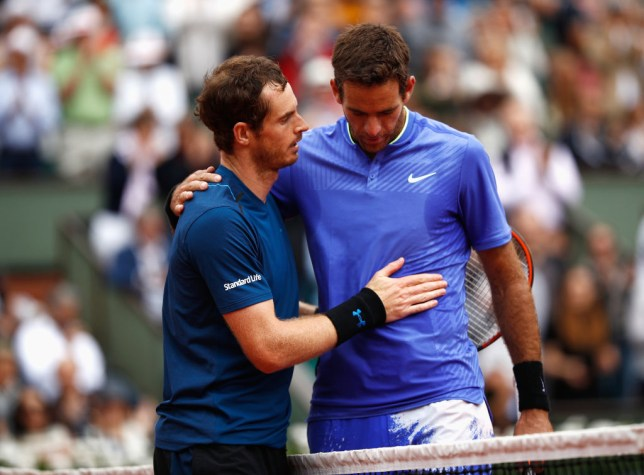 Andy Murray of Great Britain and Juan Martin Del Potro of Argentina embrace after the men's singles third round match during day seven of the French Open at Roland Garros on June 3, 2017 in Paris, France.