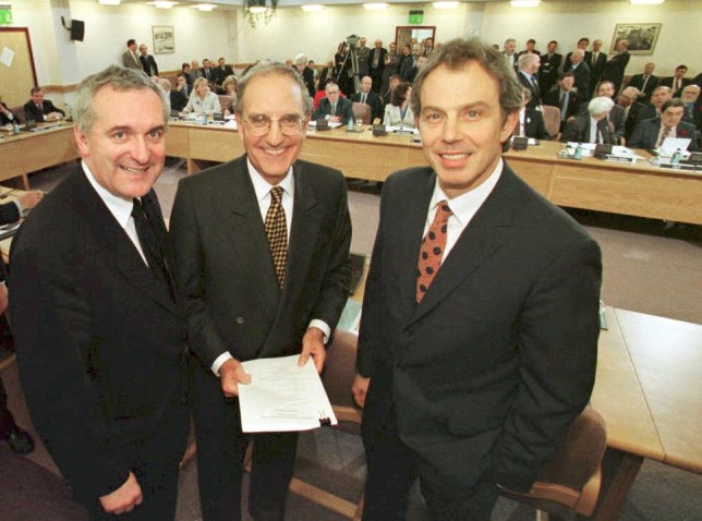 Tony Blair, George Mitchell (C) and Irish Bertie Ahern smiling at the Good Friday Agreement in 1998.