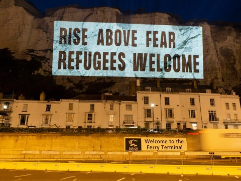 Messages welcoming refugees beamed onto White Cliffs of Dover ahead of protests