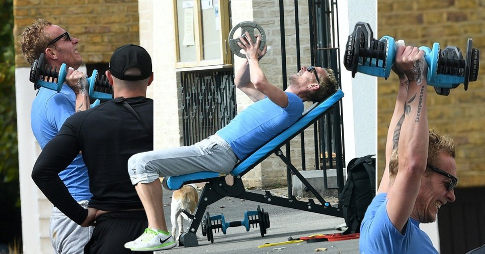 Laurence Fox working out with trainer on the street