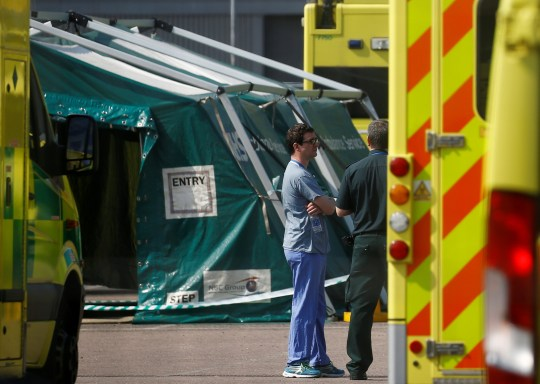 Medical staff are seen outside the NHS Nightingale Hospital at the Excel Centre in London as the spread of the coronavirus disease (COVID-19) continues, London, Britain, April 11, 2020.