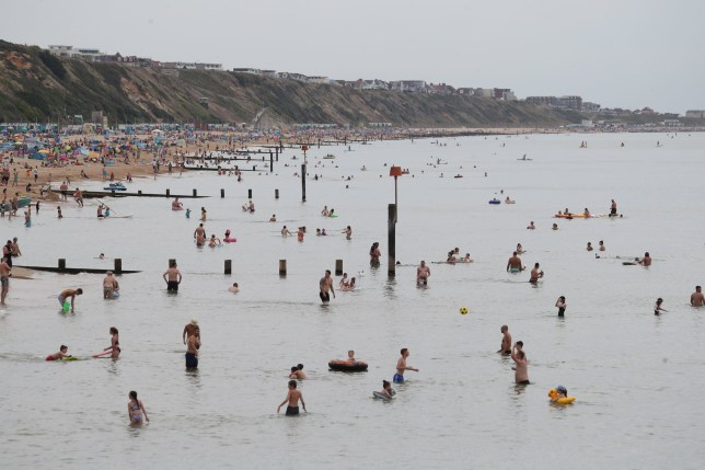 People enjoy the hot weather at Boscombe beach in Dorset. PA Photo. Picture date: Saturday August 8, 2020. Parts of the UK could see record-breaking overnight temperatures this weekend as the mini heatwave continues. See PA story WEATHER Hot. Photo credit should read: Andrew Matthews/PA Wire