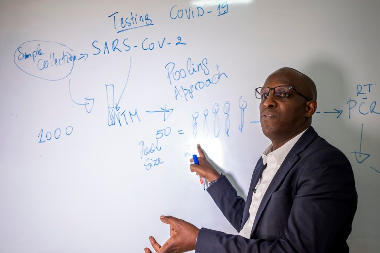Rwandan professor of human genetics and a member of the government's COVID-19 task force, Leon Mutesa, explains the pooled testing procedures for the coronavirus as he speaks to The Associated Press at the Rwanda Biomedical Center in the capital Kigali, Rwanda (Picture: AP)