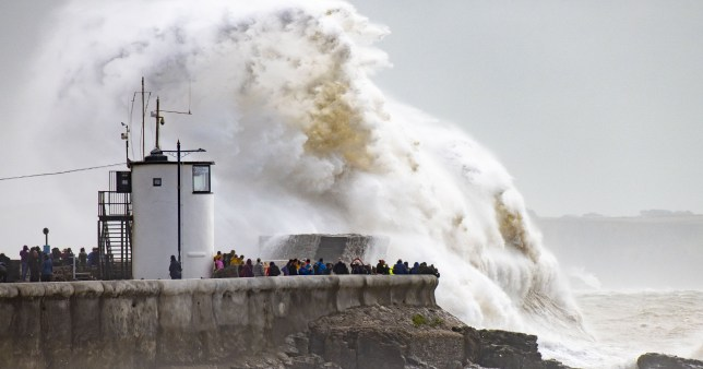 Waves crash against the harbour wall in  Porthcawl, Wales, on August 25