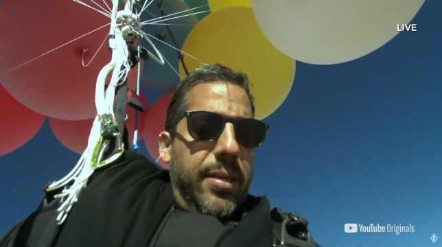David Blaine brings Up to life as he floats over Arizona while holding on to balloons in new stunt Ascension