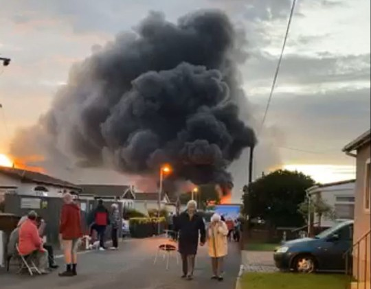 Handout photo taken from the Facebook page of Joe Dis, showing a huge blaze that firefighters have been battling at an industrial building in Kent, after reports of an explosion. PA Photo. Picture date: Friday September 4, 2020. Vast flames and a towering plume of black smoke could be seen coming from the fire in Hoo, near Rochester on Friday. See PA story FIRE Hoo. Photo credit should read: Joe Dis/Facebook/PA Wire NOTE TO EDITORS: This handout photo may only be used in for editorial reporting purposes for the contemporaneous illustration of events, things or the people in the image or facts mentioned in the caption. Reuse of the picture may require further permission from the copyright holder.