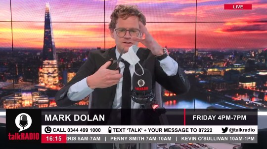 TalkRADIO's Mark Dolan cuts up face mask live on air