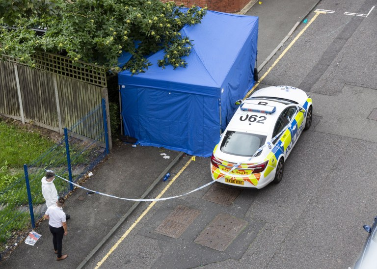 Forensic officers examines a tent, on Irving Street, as police declare a major incident in Birmingham city centre this morning following reports of multiple stabbings in the city's LGBT district, pictured in Birmingham city centre, Sep 6 2020.