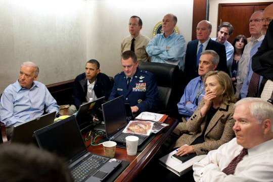 WASHINGTON, DC - MAY 1: (EDITORS NOTE: Please be advised that a classified document visible in this photo was obscured by The White House) In this handout image provided by The White House, President Barack Obama, Vice President Joe Biden, Secretary of State Hillary Clinton and members of the national security team receive an update on the mission against Osama bin Laden in the Situation Room of the White House May 1, 2011 in Washington, DC. Obama later announced that the United States had killed Bin Laden in an operation led by U.S. Special Forces at a compound in Abbottabad, Pakistan. (Photo by Pete Souza/The White House via Getty Images)