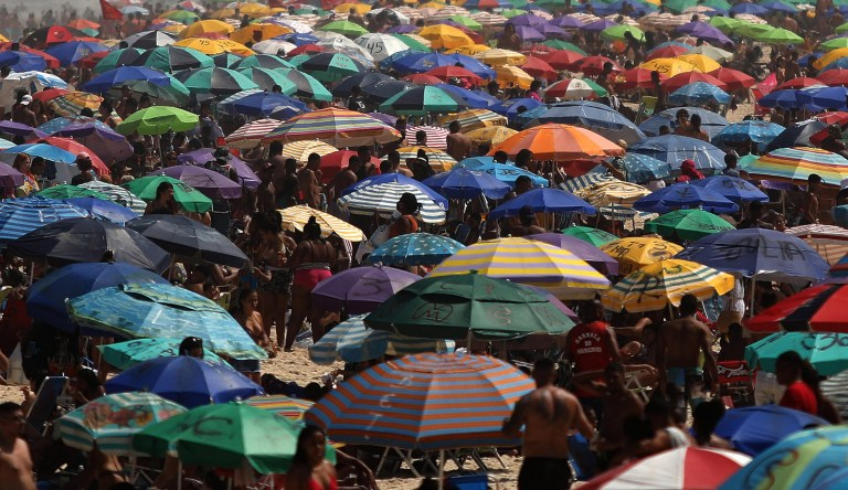 Sunbathers spend a sunny day, without keeping the social distance at the Ipanema beach in Rio de Janeiro, Brazil