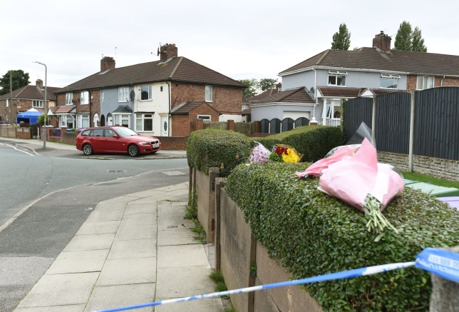 Police probe death of woman near school in Dereham Crescent Liverpool Floral tributes left nearby on Formosa Drive. Credit: Liverpool Echo