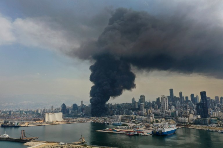 Black smoke rises from a fire at warehouses at the seaport in Beirut, Lebanon, Thursday, Sept. 10. 2020. A huge fire broke out Thursday at the Port of Beirut, triggering panic among residents traumatized by last month's massive explosion that killed and injured thousands of people. (AP Photo/Hussein Malla)