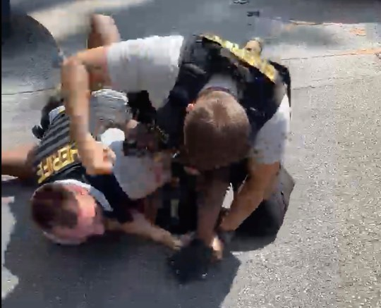 A Clayton County sheriff deputy holds down Roderick Walker while another deputy punches him while on the ground, Friday, Sept. 11, 2020.