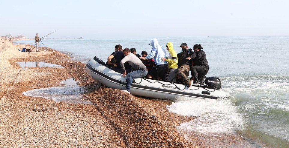 Migrants land on the Kent beach this morning