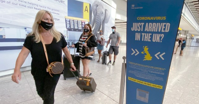 Passengers arrive at Heathrow Airport as they return from Greece, after the Government added the islands of Lesvos, Tinos, Serifos, Mykonos, Crete, Santorini and Zakynthos to the quarantine list
