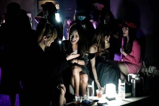 WUHAN, CHINA - SEPTEMBER 18: (CHINA OUT) People drink inside the disco bar on September 18, 2020 in Wuhan, Hubei province, China. As there have been no recorded cases of community transmission in Wuhan since May, life for residents is returning to normal. (Photo by Getty Images)