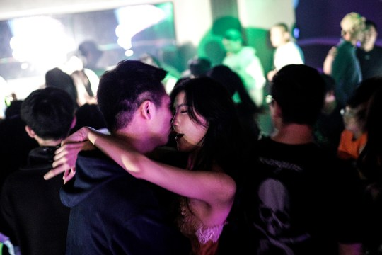 WUHAN, CHINA - SEPTEMBER 18: (CHINA OUT) People dance inside the disco bar on September 18, 2020 in Wuhan, Hubei province, China. As there have been no recorded cases of community transmission in Wuhan since May, life for residents is returning to normal. (Photo by Getty Images)