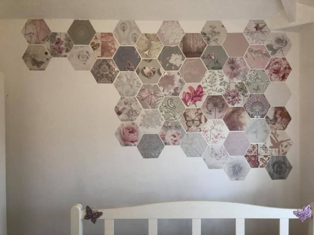 The bedroom wall as it is being transformed with the wallpaper samples.