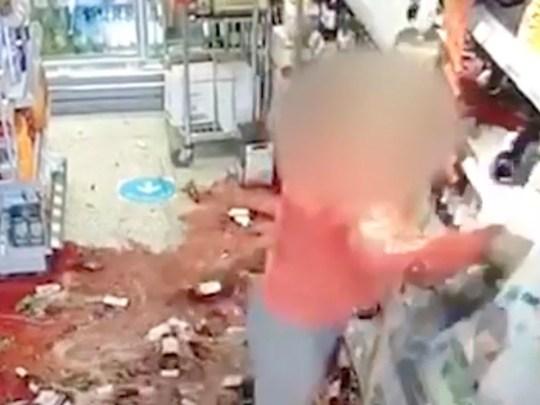 Screenshot of woman smashing up wine