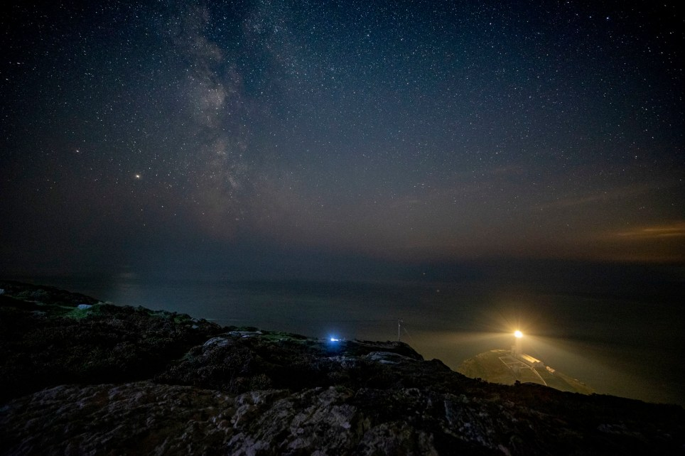The Milky Way seen behind South Stack lighthouse on the Isle of Anglesey, North Wales. PA Photo. Picture date: Monday September 21, 2020. Photo credit should read: Peter Byrne/PA Wire