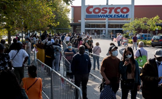 9/22/20 Pictured: Customers line up outside Costco Chingford People line up at Costco Chingford, north London, after Chief Medical Officer Chris Whitty was joined by Chief Science Advisor Sir Patrick Vallance for a televised address to the nation yesterday. Supermarkets have been reported to be stepping up security at their doors and have doubled the number of delivery slots amid fears the panic buying of Covid-19 could return.
