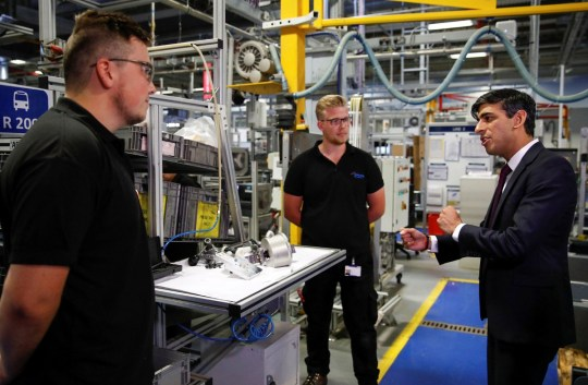 Chancellor of the Exchequer Rishi Sunak (R) speaks to employees during a visit to the Worcester Bosch factory in Worcester, central England, on July 9, 2020. - The UK government on on July 8 committed ??30 billion ($37 billion, 33 billion euros) to saving jobs and helping the young find work in an economy ravaged by the coronavirus pandemic. Delivering a mini-budget to parliament, finance minister Rishi Sunak announced bonuses to companies retaining staff and taking on apprentices, investment in eco-friendly jobs and even allowing Britons to enjoy discounted meals in some restaurants. (Photo by PHIL NOBLE / POOL / AFP) (Photo by PHIL NOBLE/POOL/AFP via Getty Images)