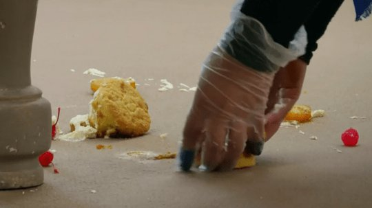 The destroyed pineapple-upside down cakes on the floor on The Great British Bake Off