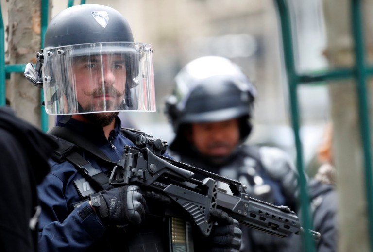 A police officer is seen at the scene of an incident near the former offices of French magazine Charlie Hebdo, in Paris, France September 25, 2020. REUTERS/Gonzalo Fuentes