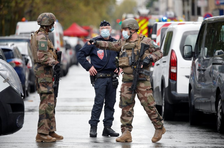 Security forces guard the scene of an incident near the former offices of French magazine Charlie Hebdo, in Paris, France September 25, 2020.