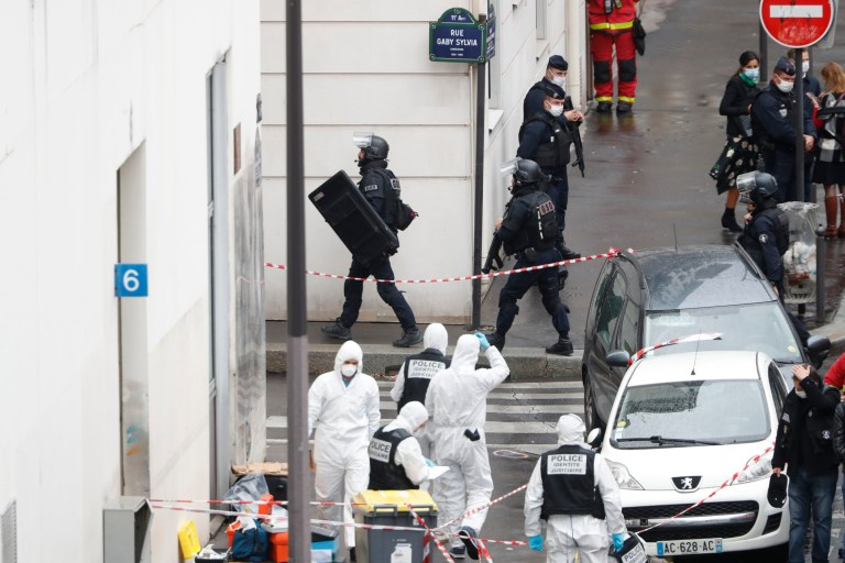 Police at the scene of a knife attack near the former offices of satirical newspaper Charlie Hebdo, Friday Sept. 25, 2020 in Paris.