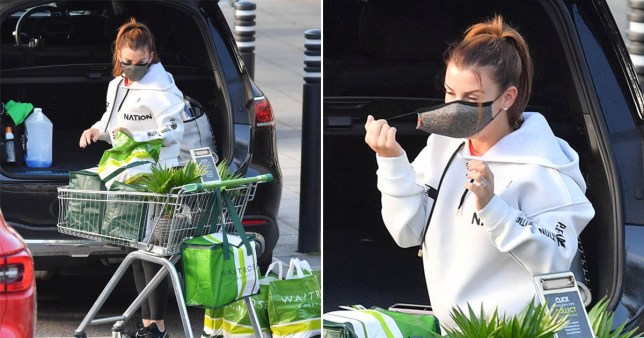 Coleen Rooney with facemask as she does shopping