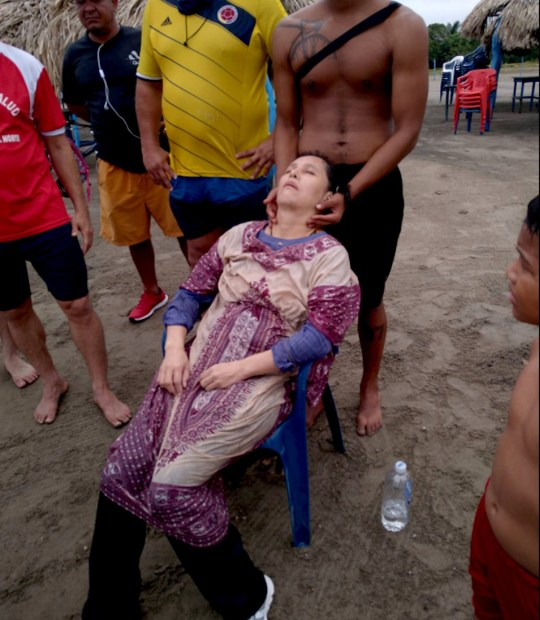 The woman being attended at the beach. (Rolando Visbal Lux/Newsflash)