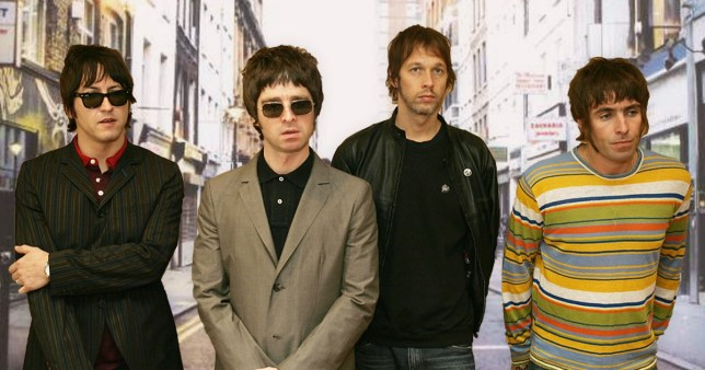 Oasis pictured in front of (What's the Story) Morning Glory? cover