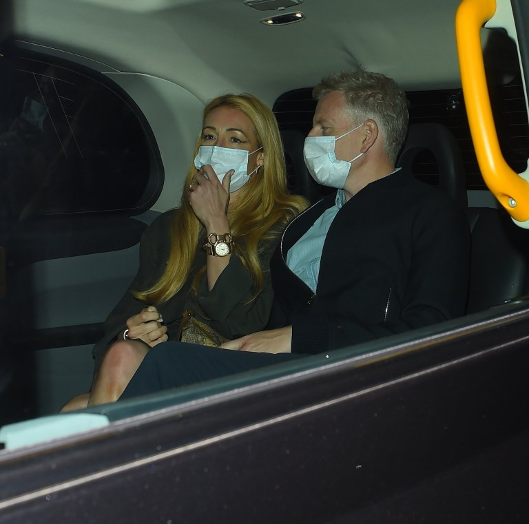 Cat Deeley and Patrick Kielty seen in a taxi outside Nobu Restaurant Park Lane