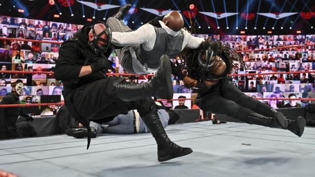 WWE faction RETRIBUBTION fight Hurt Business on Raw