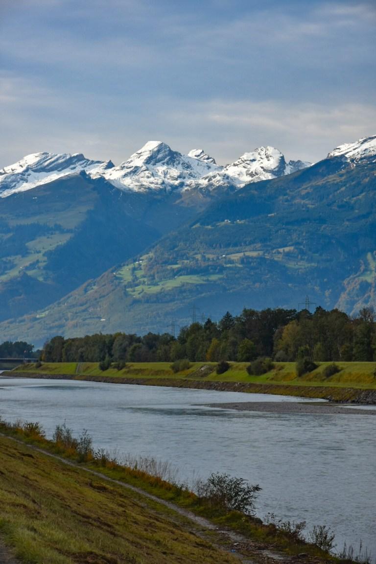 Snow-dusted peaks seen beyond the fast-flowing Rhine river (Picture: Sadie Whitelocks)