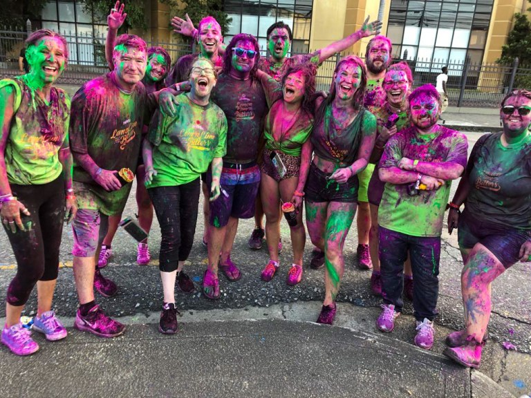 the aftermath of j'ouvert - people covered in colourful paint after the carnival