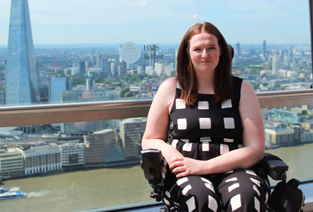 Shona in her wheelchair with London as a backdrop