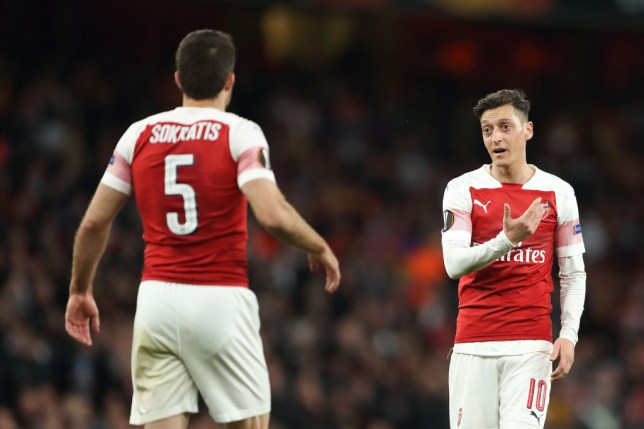 Mesut Ozil of Arsenal in discussion with Sokratis Papastathopoulos during the UEFA Europa League Semi Final First Leg match between Arsenal and Valencia at Emirates Stadium on May 2, 2019 in London, England.