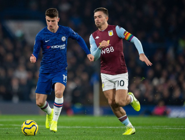 Mason Mount of Chelsea and Jack Grealish of Aston Villa during the Premier League match between Chelsea FC and Aston Villa at Stamford Bridge on December 04, 2019 in London, United Kingdom.